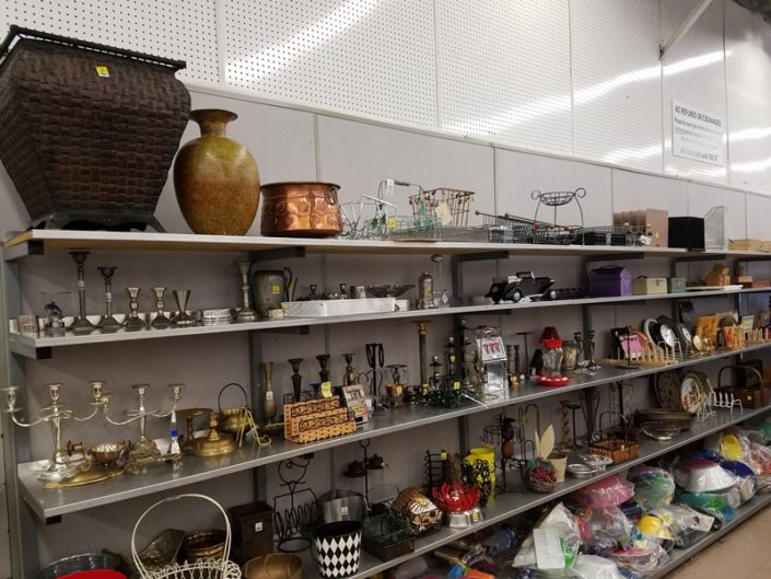antiques and decor on shelf at thrift store in azusa