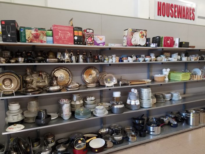 dishes, pots and pans on shelf at thrift store in azusa