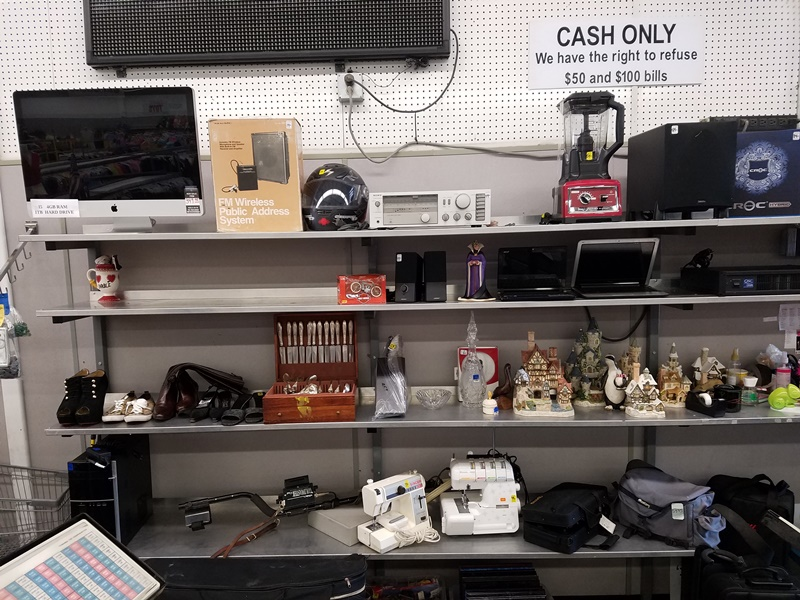 Appliances, Electronics And Home Goods On Shelf At Thrift Store In Azusa