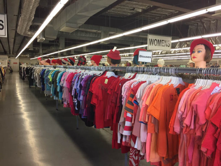 colorful clothing at thrift store in covina