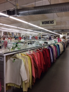 racks of clothing for sale at portland area thrift store