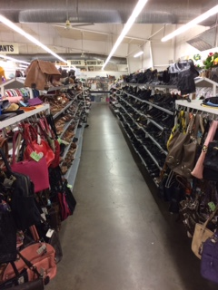 clothing and handbags at portland area thrift store