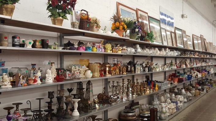 antiques and decor on display at thrift store in lake worth