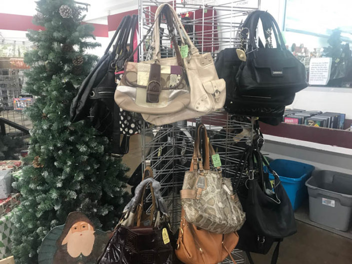 thrift store metro detroit handbags and purses displayed on rack