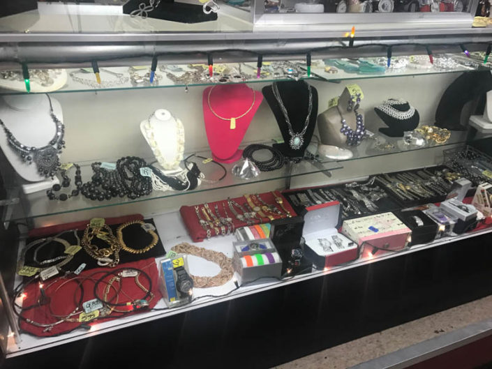 thrift store metro detroit necklaces, bracelets, rings and watches on display