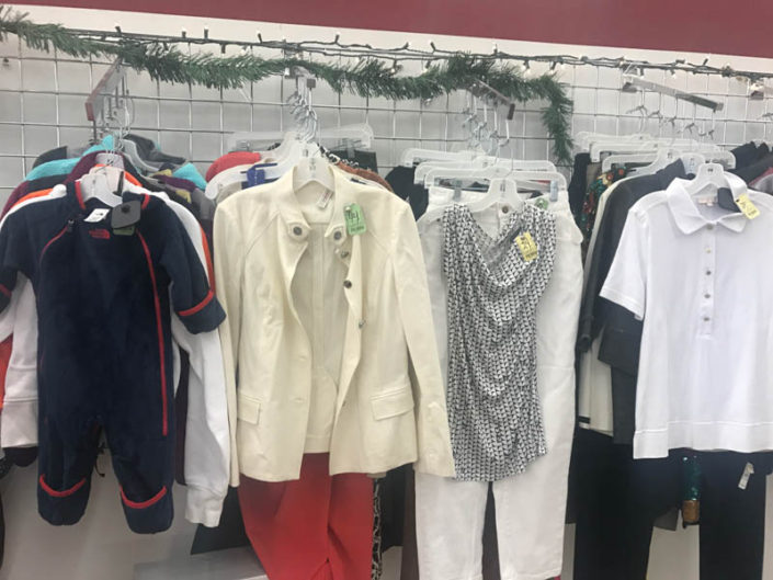 thrift store metro detroit pants, jackets and tops on display