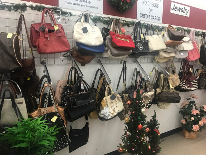 thrift store metro detroit purses and handbags on display